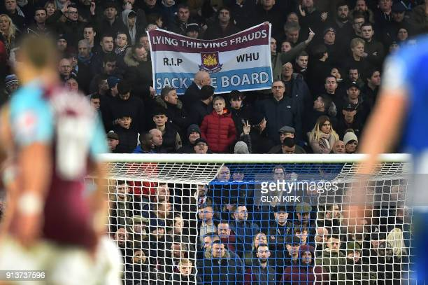West Ham United supporters protest against the club's board during the English Premier League football match between Brighton and Hove Albion and...
