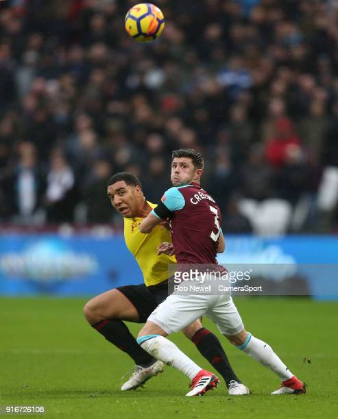 West Ham United's Aaron Cresswell and Watford's Troy Deeney during the Premier League match between West Ham United and Watford at London Stadium on...