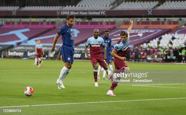 West Ham United's Aaron Cresswell clears from Chelsea's Cesar Azpilicueta during the Premier League match between West Ham United and Chelsea FC at...