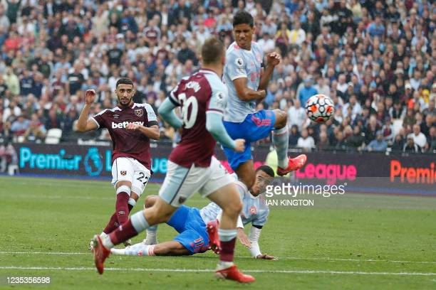 West Ham United's Algerian midfielder Said Benrahma sees his shot deflected into the goal by Manchester United's French defender Raphael Varane for...