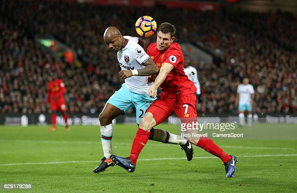 West Ham United's Andre Ayew and Liverpool's James Milner during the Premier League match between Liverpool and West Ham United at Anfield on...