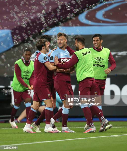 West Ham United's Andriy Yarmolenko celebrates scoring his side's third goal with Aaron Cresswell and Albian Ajeti during the Premier League match...