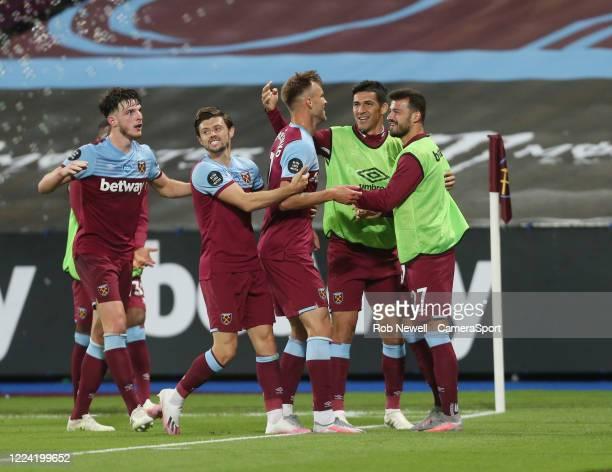West Ham United's Andriy Yarmolenko celebrates scoring his side's third goal with Aaron Cresswell Declan Rice Fabian Balbuena and Albian Ajeti during...