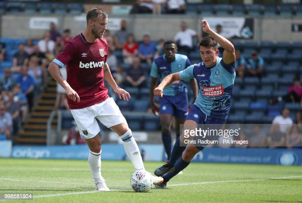 West Ham United's Andriy Yarmolenko is challenged by Wycombe Wanderers Luke O'Nein during a preseason match at Adams Park Wycombe