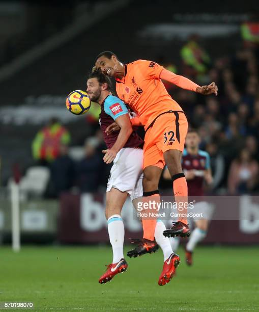 West Ham United's Andy Carroll and Liverpool's Joel Matip during the Premier League match between West Ham United and Liverpool at London Stadium on...