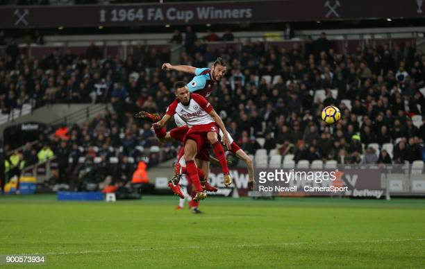 West Ham United's Andy Carroll scores his side's first goal during the Premier League match between West Ham United and West Bromwich Albion at...