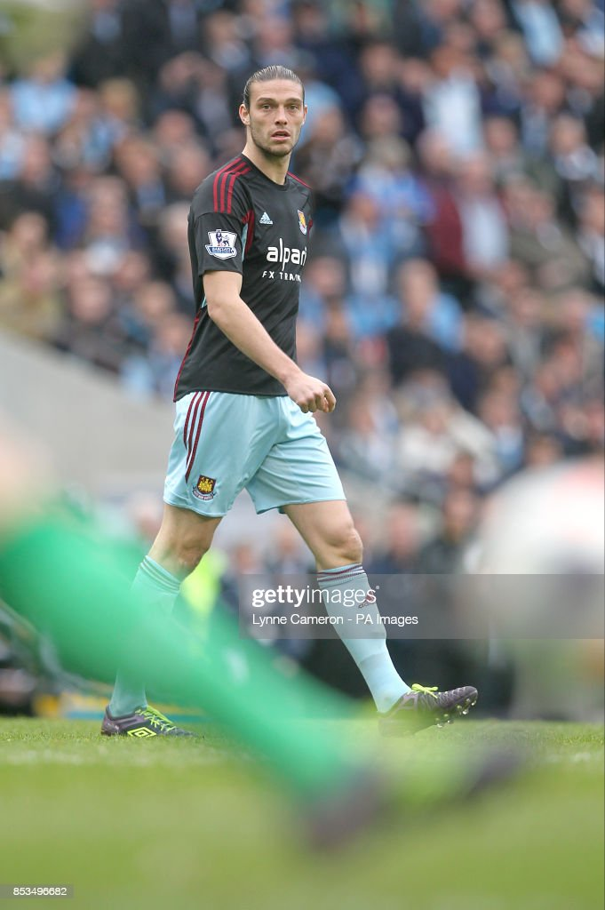 West Ham United's Andy Carroll wearing Umbro football boots watches