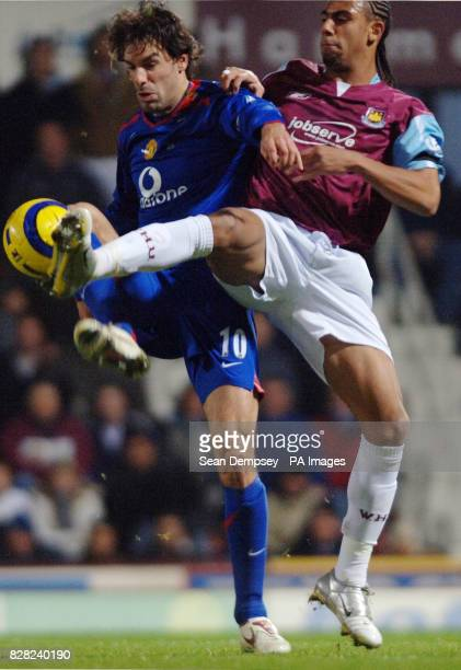 West Ham United's Anton Ferdinand challenges Manchester United's Ruud van Nistelrooy during the Barclays Premiership match at Upton Park London...