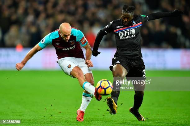 West Ham United's Argentinian defender Pablo Zabaleta is challenged by Crystal Palaces Frenchborn Malian midfielder Bakary Sako during the English...