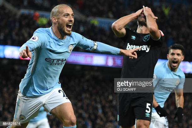 West Ham United's Argentinian defender Pablo Zabaleta reacts as Manchester City's Spanish midfielder David Silva celebrates scoring their second goal...