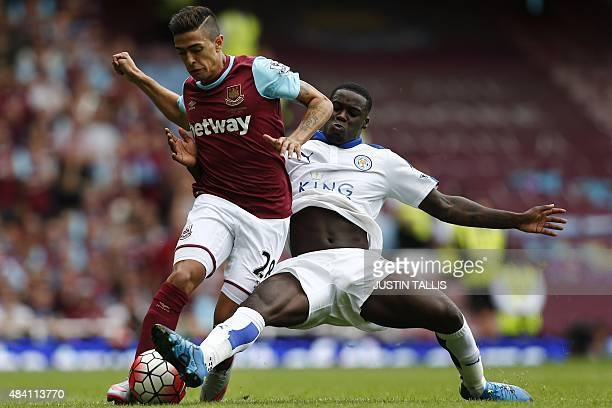 West Ham United's Argentinian midfielder Manuel Lanzani vies for the ball with Leicester City's Ghanaian striker Jeff Schlupp during the English...