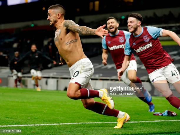 TOPSHOT West Ham United's Argentinian midfielder Manuel Lanzini celebrates scoring their third goal during the English Premier League football match...