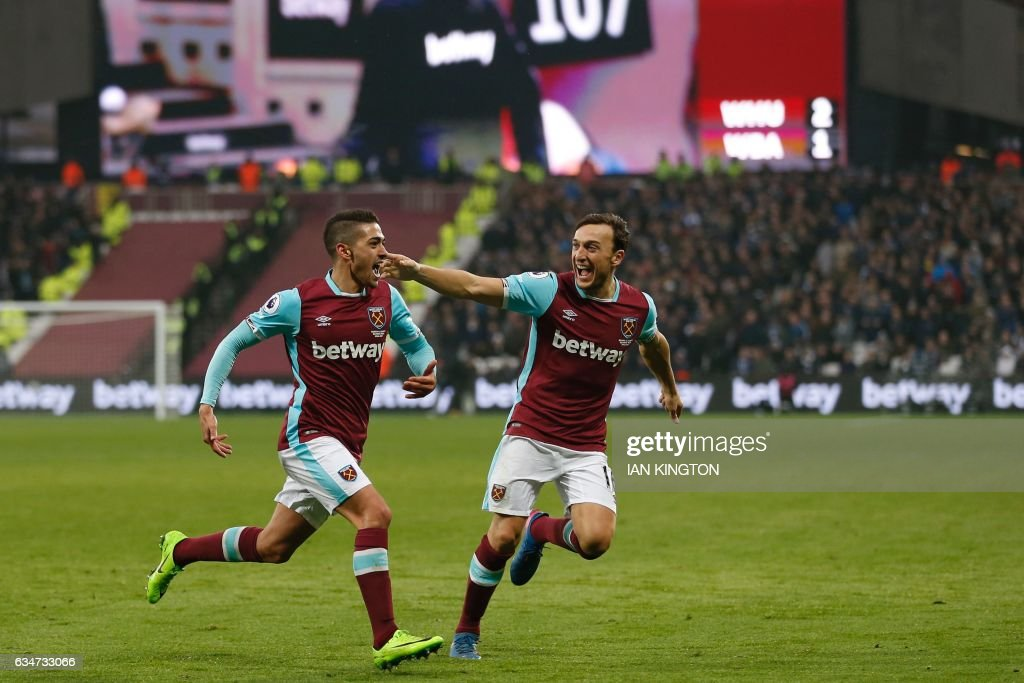 West Ham United's Argentinian midfielder Manuel Lanzini (L) celebrates with West Ham United's English midfielder Mark Noble after scoring their second goal during the English Premier League football match between West Ham United and West Bromwich Albion at The London Stadium, in east London on February 11, 2017. The game finished 2-2. / AFP / Ian KINGTON / RESTRICTED TO EDITORIAL USE. No use with unauthorized audio, video, data, fixture lists, club/league logos or 'live' services. Online in-match use limited to 75 images, no video emulation. No use in betting, games or single club/league/player publications. /