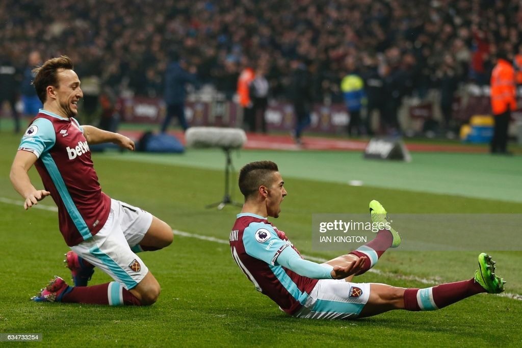 West Ham United's Argentinian midfielder Manuel Lanzini (R) celebrates with West Ham United's English midfielder Mark Noble after scoring their second goal during the English Premier League football match between West Ham United and West Bromwich Albion at The London Stadium, in east London on February 11, 2017. The game finished 2-2. / AFP / Ian KINGTON / RESTRICTED TO EDITORIAL USE. No use with unauthorized audio, video, data, fixture lists, club/league logos or 'live' services. Online in-match use limited to 75 images, no video emulation. No use in betting, games or single club/league/player publications. /