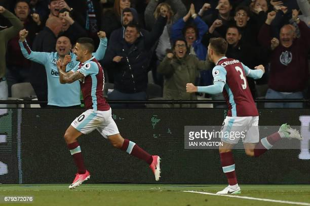 West Ham United's Argentinian midfielder Manuel Lanzini celebrates after scoring the opening goal of the English Premier League football match...