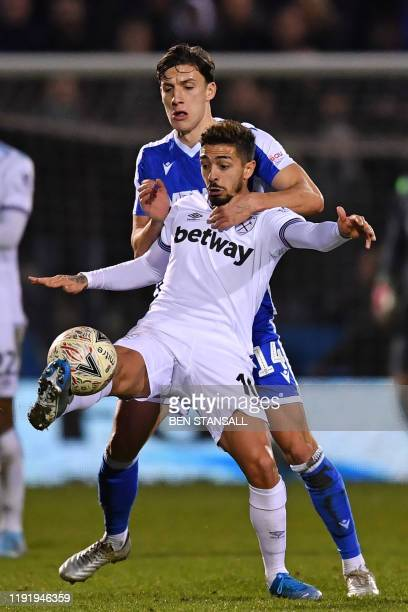 West Ham United's Argentinian midfielder Manuel Lanzini vies with Gillingham's English defender Alfie Jones during the English FA Cup third round...