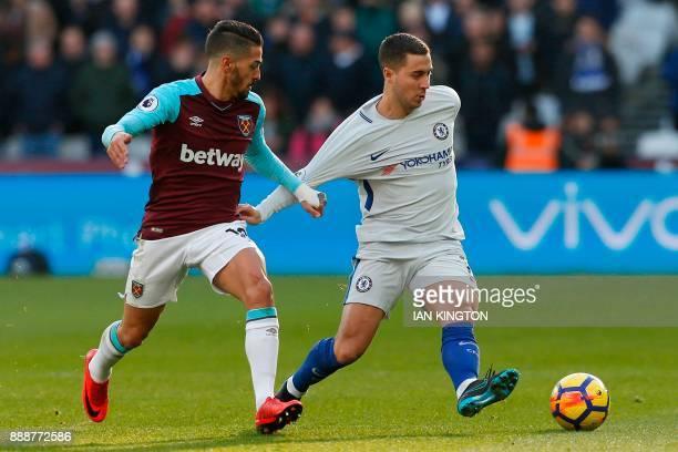 West Ham United's Argentinian midfielder Manuel Lanzini vies with Chelsea's Belgian midfielder Eden Hazard during the English Premier League football...