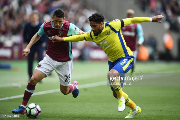 West Ham United's Argentinian striker Jonathan Calleri is tackled by Everton's Englishborn Welsh defender Ashley Williams during the English Premier...