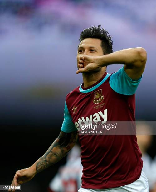 West Ham United's Argentinian striker Mauro Zarate celebrates after scoring the opening goal of the English Premier League football match between...