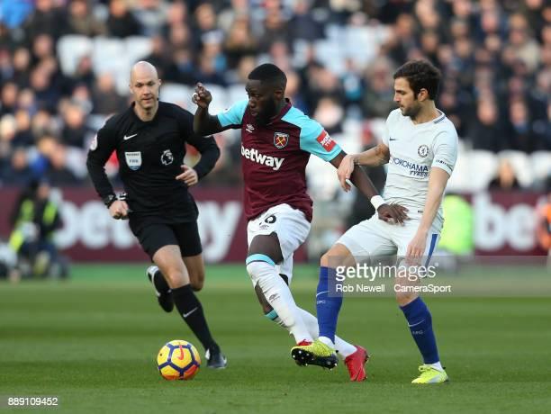 West Ham United's Arthur Masuaku and Chelsea's Cesc Fabregas during the Premier League match between West Ham United and Chelsea at London Stadium on...