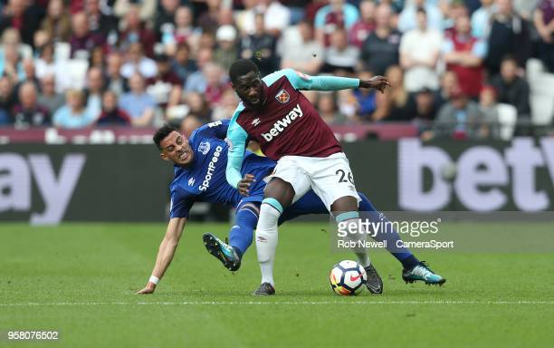 West Ham United's Arthur Masuaku is challenged by Everton's Ramiro Funes Mori and is forced off with an injury during the Premier League match...