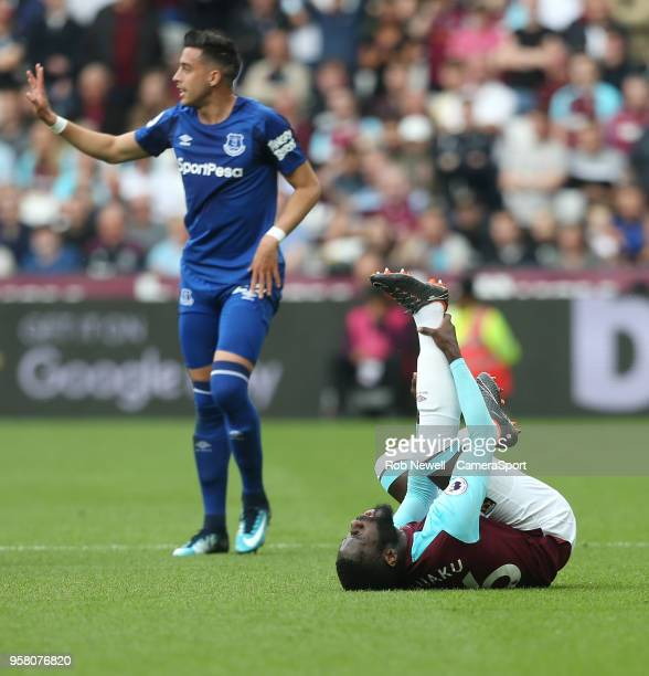 West Ham United's Arthur Masuaku is in pain after being challenged by Everton's Ramiro Funes Mori and is forced off with an injury during the Premier...