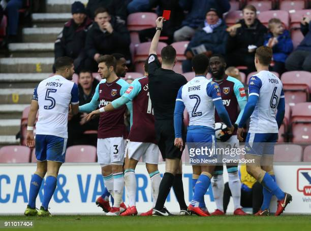 West Ham United's Arthur Masuaku receives a red card during the The Emirates FA Cup Fourth Round match between Wigan Athletic and West Ham United at...