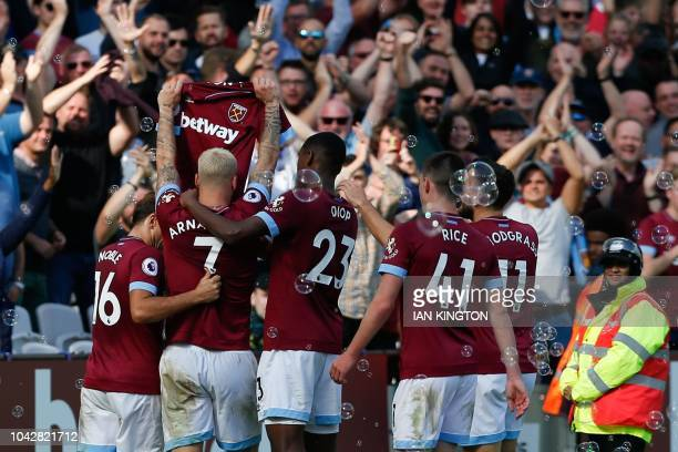 West Ham United's Austrian midfielder Marko Arnautovic celebrates after scoring their third goal during the English Premier League football match...