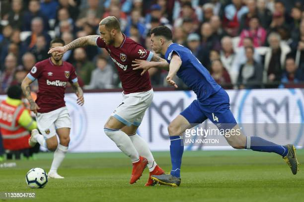 West Ham United's Austrian midfielder Marko Arnautovic vies with Everton's English defender Michael Keane during the English Premier League football...