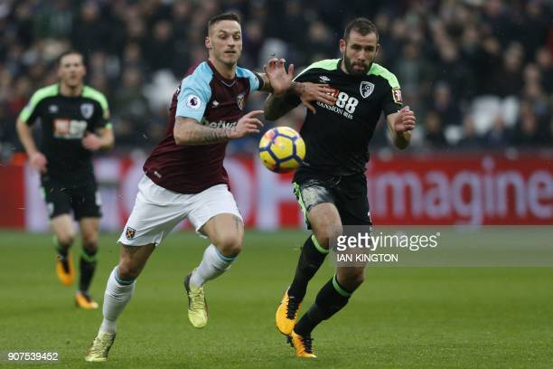 West Ham United's Austrian midfielder Marko Arnautovic vies with Bournemouth's English defender Steve Cook during the English Premier League football...