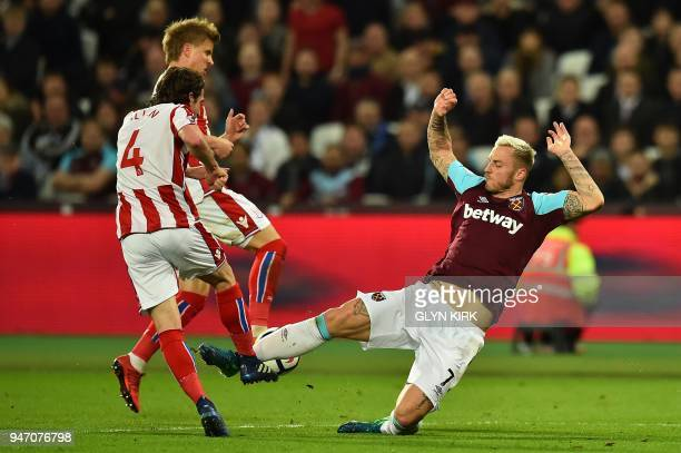 TOPSHOT West Ham United's Austrian midfielder Marko Arnautovic vies with Stoke City's Austrian defender Moritz Bauer and Stoke City's Welsh...