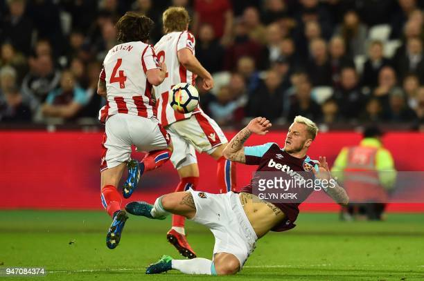 West Ham United's Austrian midfielder Marko Arnautovic vies with Stoke City's Austrian defender Moritz Bauer and Stoke City's Welsh midfielder Joe...