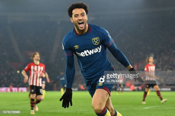 West Ham United's Brazilian midfielder Felipe Anderson celebrates after scoring their second goal during the English Premier League football match...