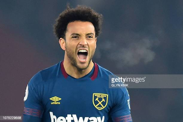 West Ham United's Brazilian midfielder Felipe Anderson celebrates after scoring their first goal during the English Premier League football match...