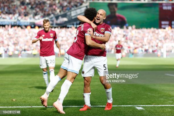 West Ham United's Brazilian midfielder Felipe Anderson celebrates scoring the opening goal with West Ham United's Argentinian defender Pablo Zabaleta...
