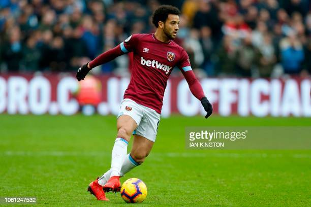 West Ham United's Brazilian midfielder Felipe Anderson looks to pass the ball during the English Premier League football match between West Ham...