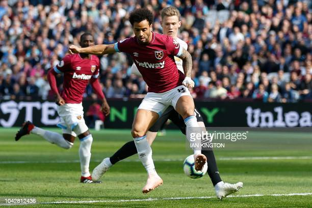 West Ham United's Brazilian midfielder Felipe Anderson scores the opening goal during the English Premier League football match between West Ham...