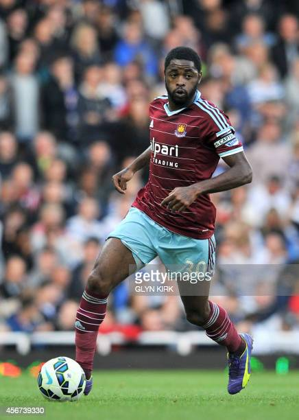 West Ham United's Cameroonian midfielder Alex Song controls the ball during the English Premier League football match against Queens Park Rangers at...