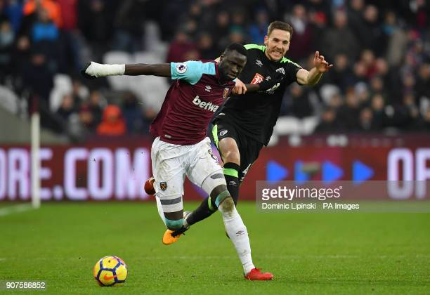 West Ham United's Cheikhou Kouyate and AFC Bournemouth's Dan Gosling battle for the ball during the Premier League match at London Stadium