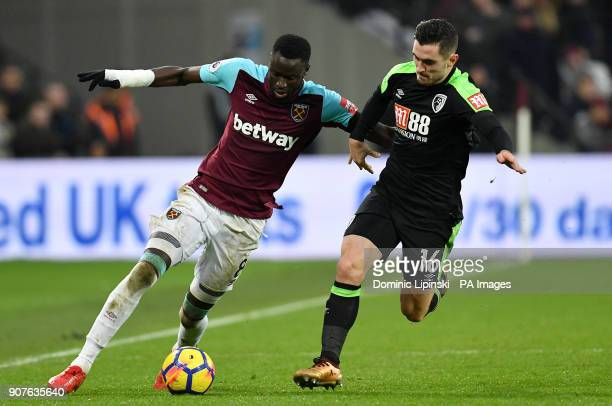 West Ham United's Cheikhou Kouyate and AFC Bournemouth's Lewis Cook battle for the ball during the Premier League match at London Stadium