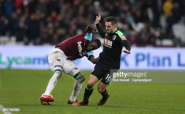 West Ham United's Cheikhou Kouyate and Bournemouth's Lewis Cook during the Premier League match between West Ham United and AFC Bournemouth at London...
