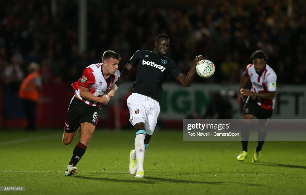 West Ham United's Cheikhou Kouyate and Cheltenham Town's Kevin Dawson during the Carabao Cup Second Round match between Cheltenham Town and West Ham United at Whaddon Road on August 23, 2017 in Cheltenham, England.