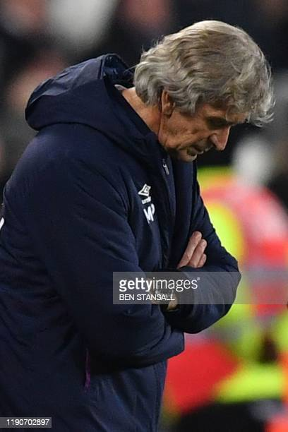 West Ham United's Chilean manager Manuel Pellegrini gestures from the touchline during the English Premier League football match between West Ham...