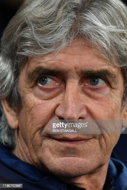 West Ham United's Chilean manager Manuel Pellegrini takes his seat for the English Premier League football match between West Ham United and...