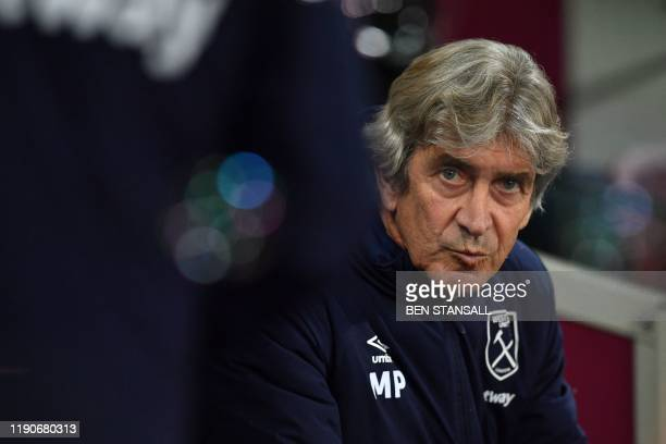 West Ham United's Chilean manager Manuel Pellegrini takes his seat before kick off of the English Premier League football match between West Ham...