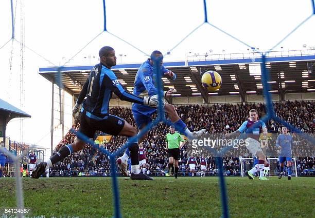 West Ham United's Craig Bellamy scores the third West Ham goal past Portsmouth goalkeeper David James during their Premiership football match at...