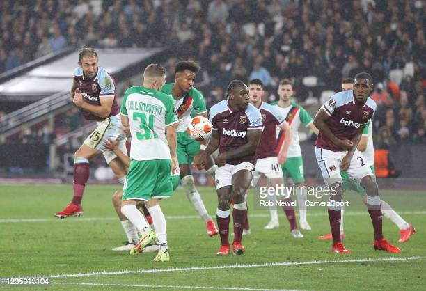 West Ham United's Craig Dawson with a header in the first half during the UEFA Europa League group H match between West Ham United and Rapid Wien at...