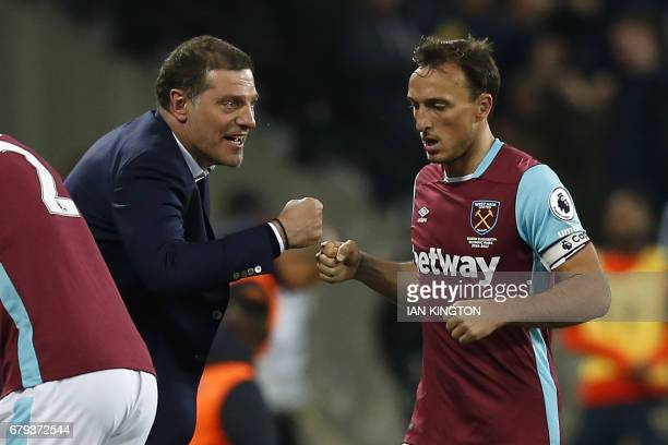 West Ham United's Croatian manager Slaven Bilic celebrates with West Ham United's English midfielder Mark Noble after West Ham take the lead in the...