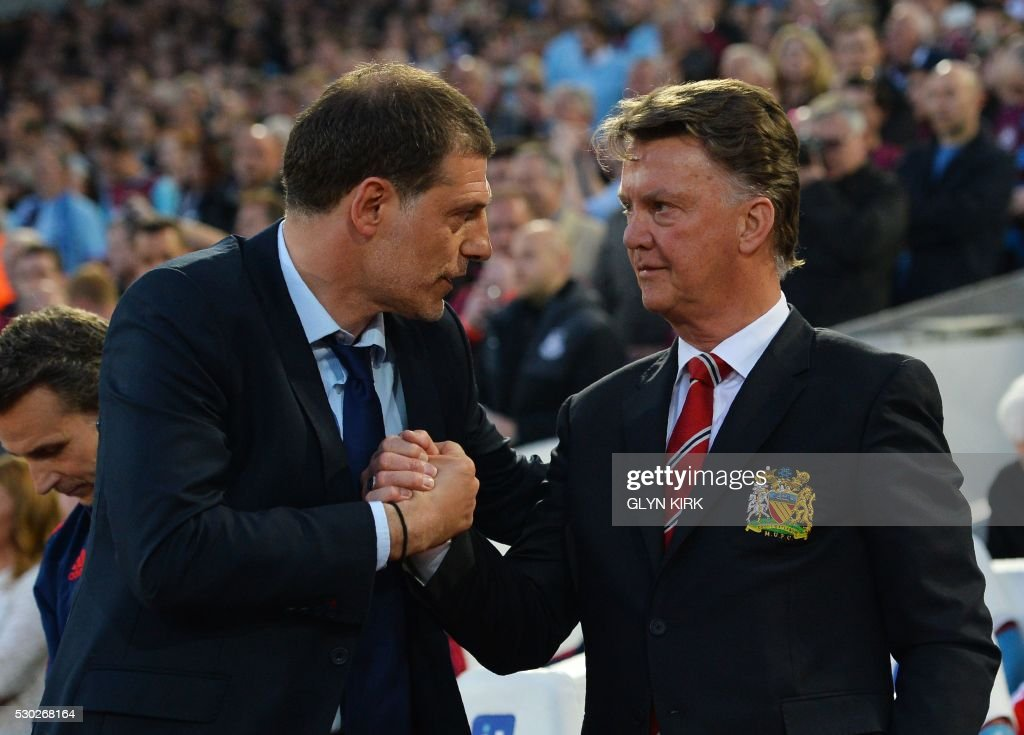 TOPSHOT - West Ham United's Croatian manager Slaven Bilic (L) greets Manchester United's Dutch manager Louis van Gaal before the English Premier League football match between West Ham United and Manchester United at The Boleyn Ground in Upton Park, in east London on May 10, 2016. / AFP PHOTO / GLYN KIRK / RESTRICTED TO EDITORIAL USE. No use with unauthorized audio, video, data, fixture lists, club/league logos or 'live' services. Online in-match use limited to 75 images, no video emulation. No use in betting, games or single club/league/player publications. /