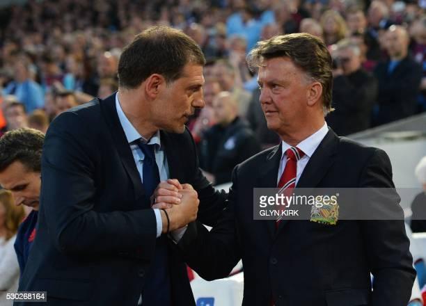 TOPSHOT West Ham United's Croatian manager Slaven Bilic greets Manchester United's Dutch manager Louis van Gaal before the English Premier League...